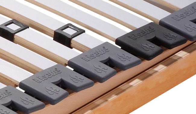 Das Bild zeigt die Lagerung der Federholzleisten von einem verstellbaren Lattenrost.